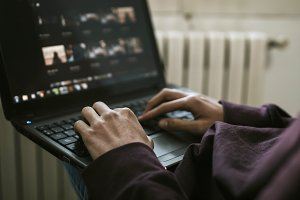 close-up of the young man with the laptop at home working
