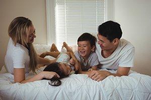 Happy family enjoy in bedroom