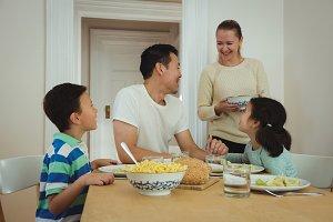 Happy family having meal