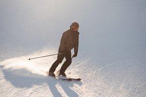 Skier skiing on the mountain slope