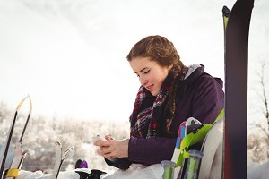 Woman on her smartphone in montains