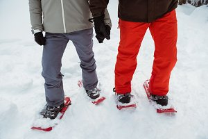 Skier couple with snow shoes on snowy landscape