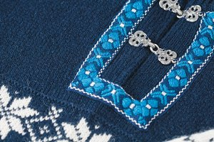 Close-up of a blue and white Norwegian wool sweater
