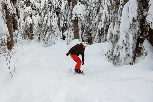 Man snowboarding on snowy mountain