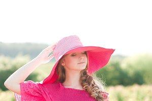 Stylish girl in meadow