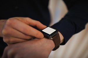 Business executive using smartwatch