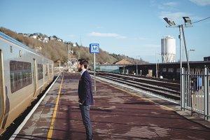 Businessman standing at railway station