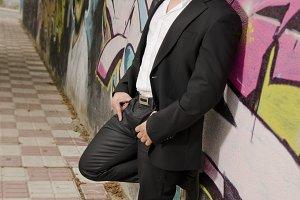 Elegant casual suit man and graffiti
