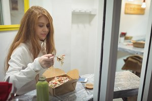 Beautiful woman eating salad