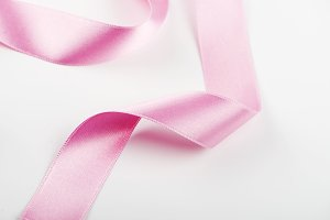 Pink ribbon on white background. Isolated.