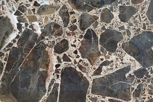 Textured brown marble stone background.