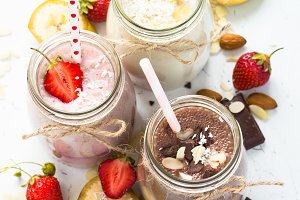 Banana chocolate and strawberry milkshakes