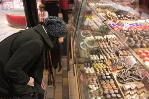Woman looking at desserts at dessert counter