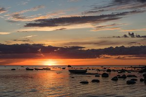 sunset at the baltic sea with boats