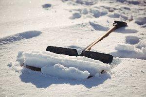 Shovel covered in snow