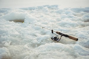 Fishing rod around ice hole