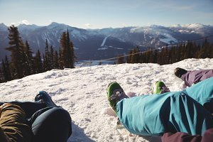 Three skiers relaxing on snow covered mountain