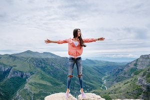 joyful woman travel mountains