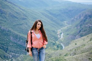 joyful woman travel mountains