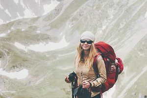 Woman traveler enjoying mountains