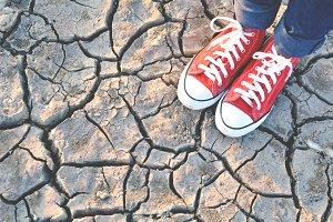 sneaker on crack dry ground