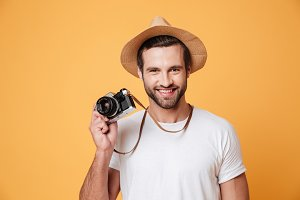 Horizontal image of a positive man holding camera
