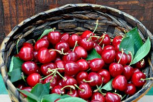 Fresh red cherries in a basket