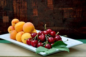 Fresh red cherries and apricots