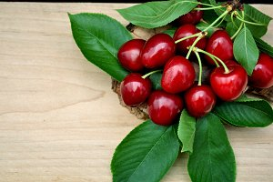 Fresh cherries and green leaves