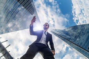 Businessman with smartphone seen with fisheye
