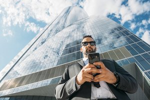 Business man chatting with smartphone