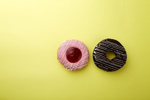 donuts on a yellow background with copy space