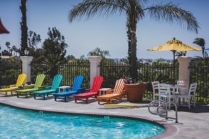Pool with colorful lounge chairs