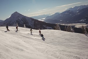 Group of skiers skiing in snowy alps