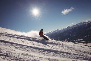Skier skiing in snowy alps