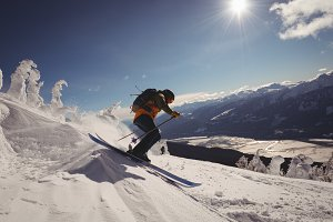 Skier skiing in snowy alps