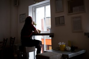 Woman drinking health drink in café