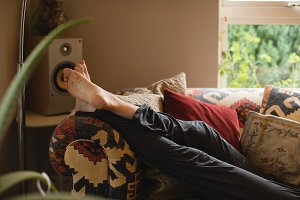 Woman lying on couch in living room
