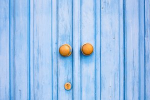 Blue door with a knobs and keyhole