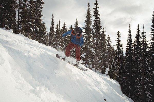 Man snowboarding on mountain