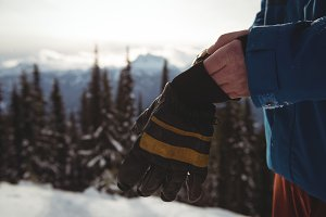 Midsection of man wearing gloves during winter