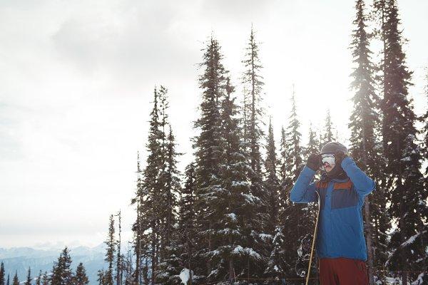Man wearing helmet against trees