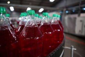 Cold drink bottles on production line