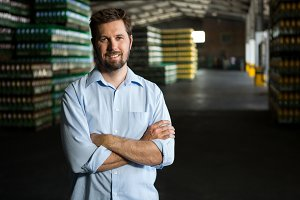 Confident male worker standing in warehouse
