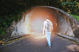 Man finding the light at the tunnel - hope,freedom and success concept