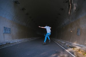 Man in tunnel jumping with happiness in tunnel - happiness and freedom life