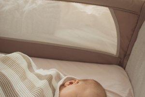 Cute baby sleeping in crib