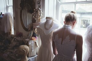 Rear view of young bride in white wedding dress