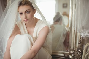 Portrait of young bride in a white dress