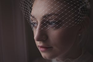 Close-up of young bridal wearing birdcage veil